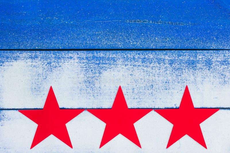 Κενό σημάδι παραλιών με τα κόκκινα αστέρια και τη σύσταση άμμου στοκ εικόνα με δικαίωμα ελεύθερης χρήσης