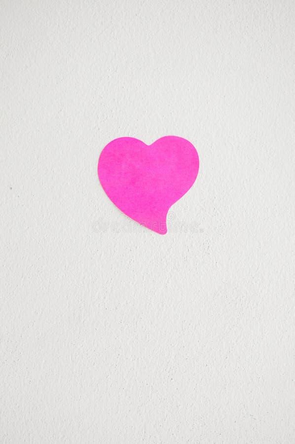 Κενό σημειωματάριο ή κολλώδες ροζ σημειώσεων στο άσπρο backgro τοίχων κονιάματος στοκ φωτογραφία με δικαίωμα ελεύθερης χρήσης