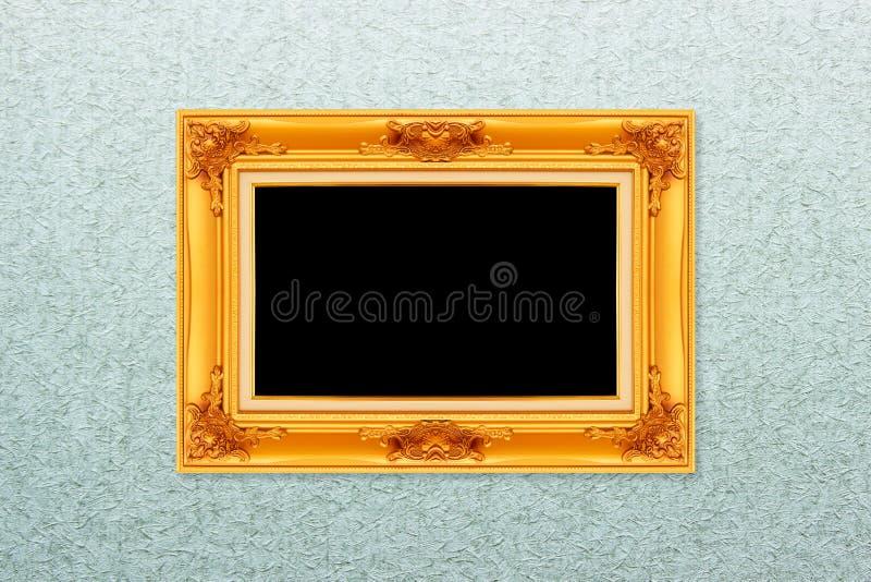 Κενό χρυσό εκλεκτής ποιότητας πλαίσιο στην ταπετσαρία στοκ εικόνες