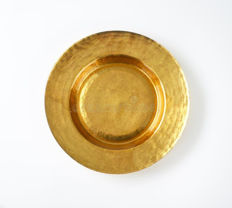 Κενό χρυσό πιάτο στοκ φωτογραφίες
