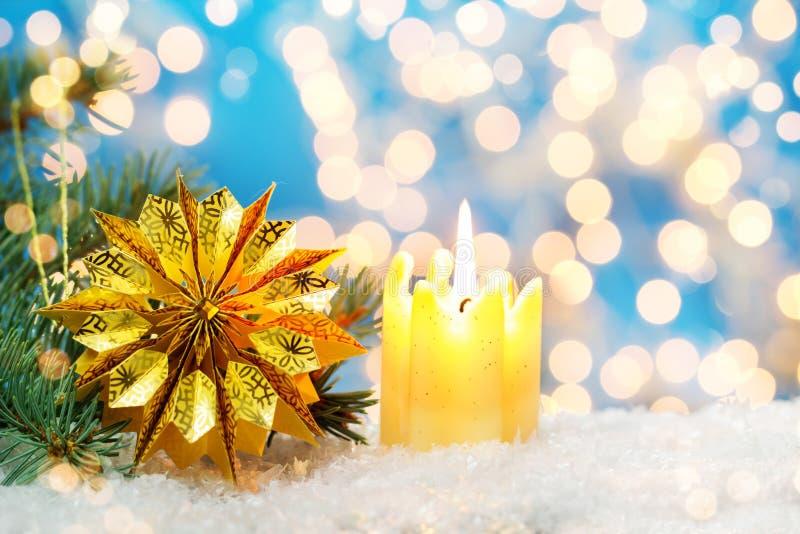 Κερί και χρυσό αστέρι στοκ εικόνες