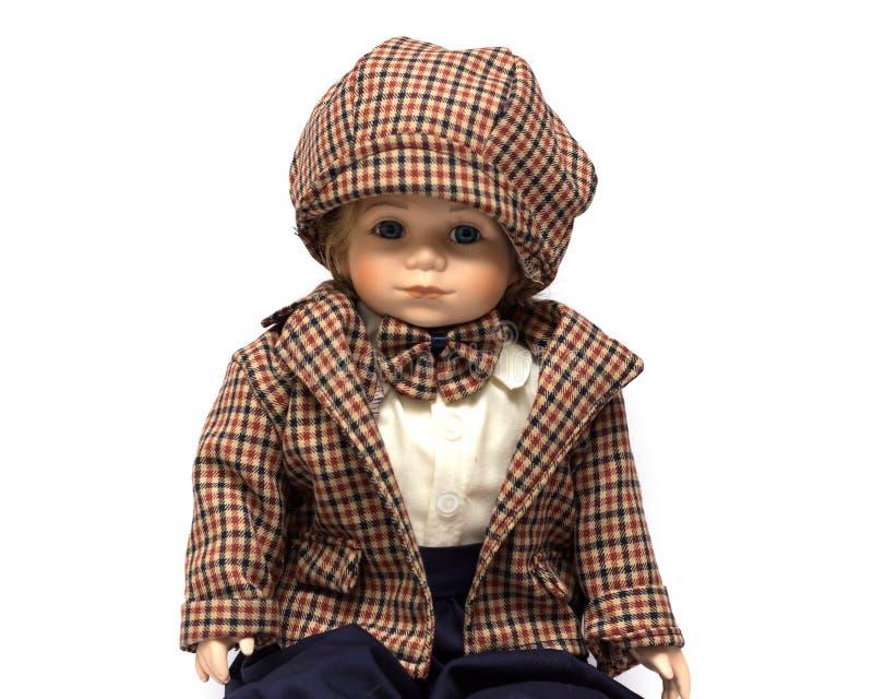 Κεραμική χειροποίητη εκλεκτής ποιότητας κούκλα πορσελάνης του αγοριού brunette με τη σγουρή τρίχα στοκ εικόνες