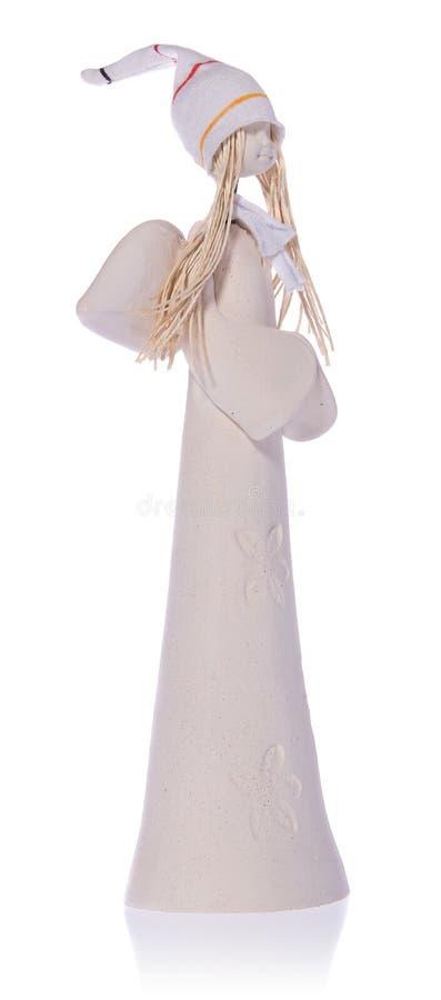 Κεραμικός άσπρος άγγελος με τη μακροχρόνια άσπρη τρίχα και μια ΚΑΠ στοκ φωτογραφία με δικαίωμα ελεύθερης χρήσης
