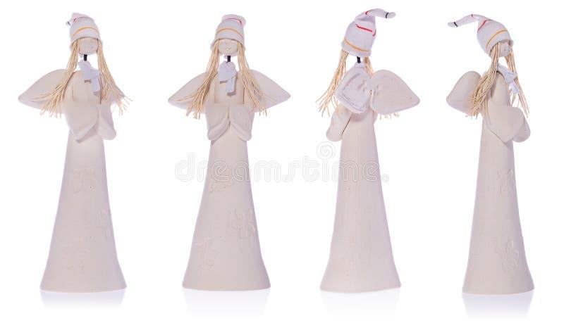 Κεραμικός άσπρος άγγελος με τη μακροχρόνια άσπρη τρίχα και μια ΚΑΠ στοκ φωτογραφίες με δικαίωμα ελεύθερης χρήσης