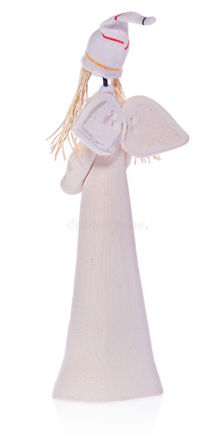 Κεραμικός άσπρος άγγελος με τη μακροχρόνια άσπρη τρίχα και μια ΚΑΠ στοκ εικόνα με δικαίωμα ελεύθερης χρήσης