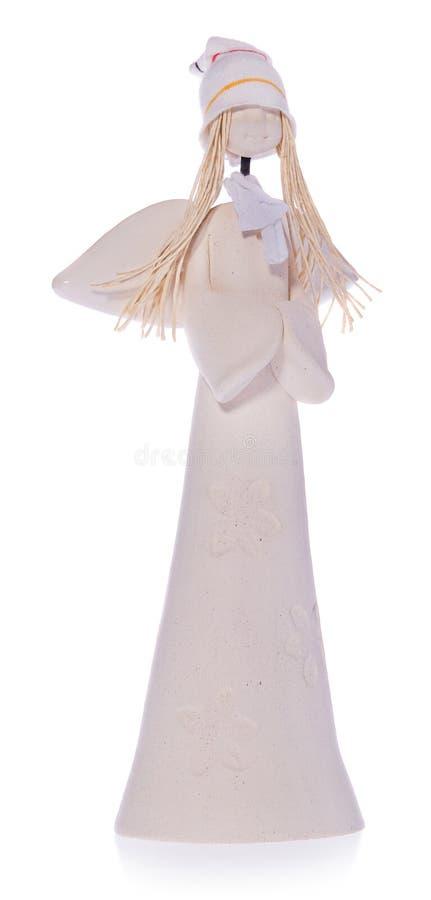 Κεραμικός άσπρος άγγελος με τη μακροχρόνια άσπρη τρίχα και μια ΚΑΠ στοκ εικόνες