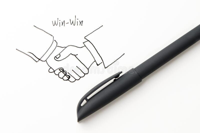 Κερδίστε κερδίζει την επιχείρηση με τα σύμβολα χεριών κουνημάτων στοκ φωτογραφία με δικαίωμα ελεύθερης χρήσης
