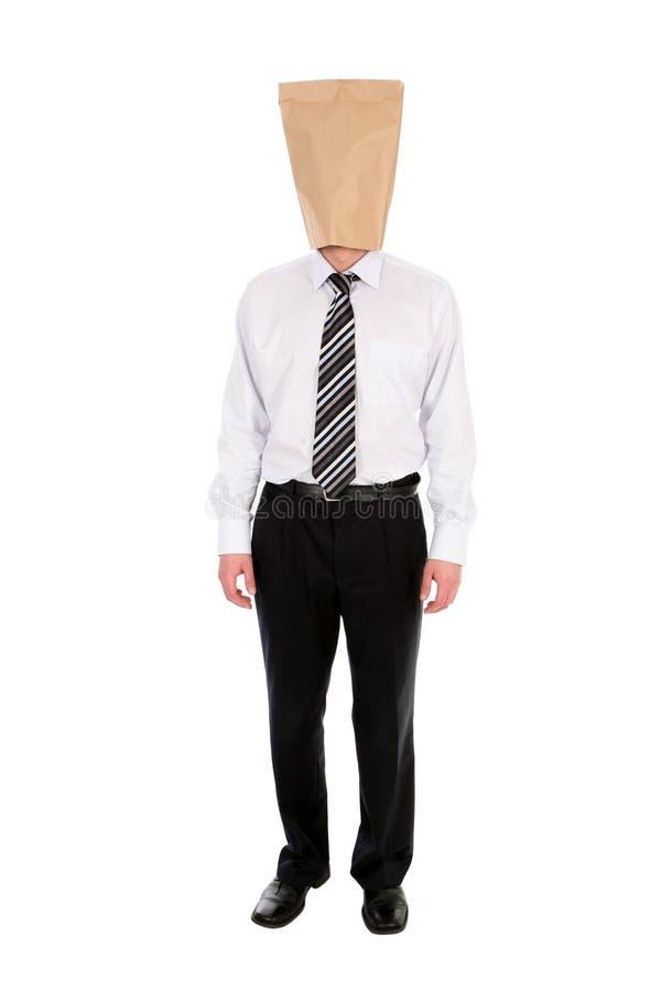 κεφάλι επιχειρηματιών τσαντών πέρα από το έγγραφο στοκ φωτογραφία