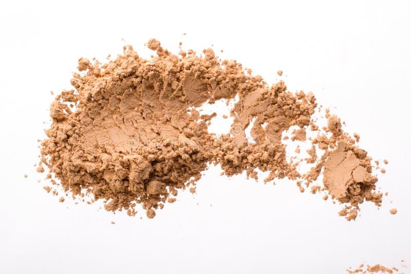 Κηλίδα από τον ξηρό κίτρινο καλλυντικό άργιλο Σύσταση της σκόνης makeup - κοκκινίστε ή σκιά ματιών η σκούπα απομόνωσε το λε&u στοκ φωτογραφίες με δικαίωμα ελεύθερης χρήσης