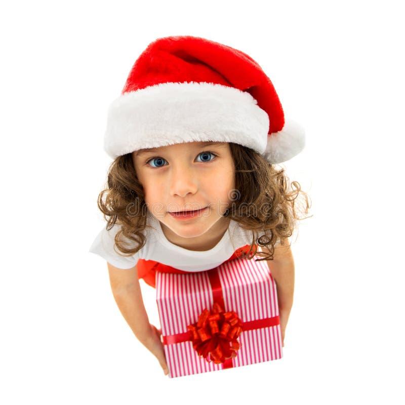 Κιβώτιο δώρων Χριστουγέννων εκμετάλλευσης παιδιών υπό εξέταση Απομονωμένος στο λευκό στοκ φωτογραφίες