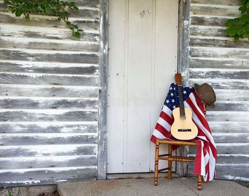 Κιθάρα και καπέλο στη σημαία στοκ εικόνες