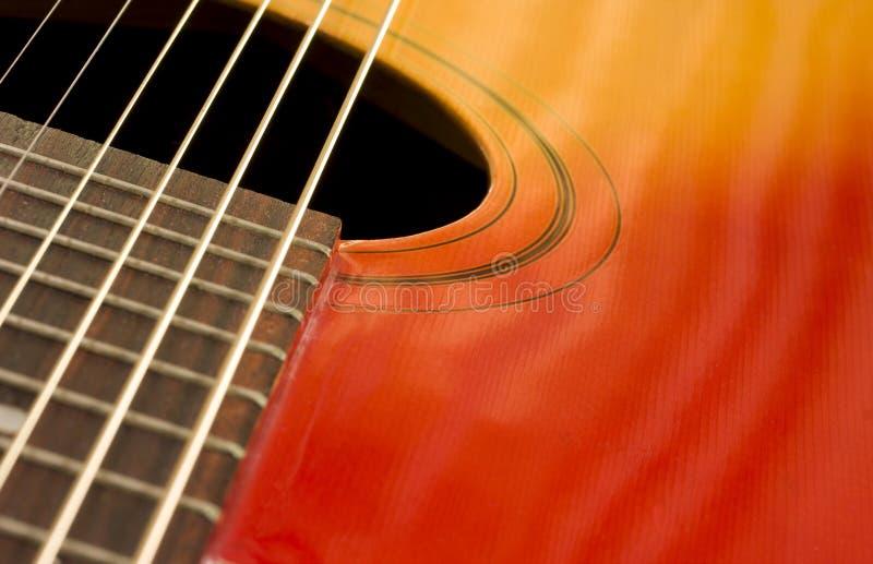 κιθάρα κινηματογραφήσεων σε πρώτο πλάνο στοκ φωτογραφία