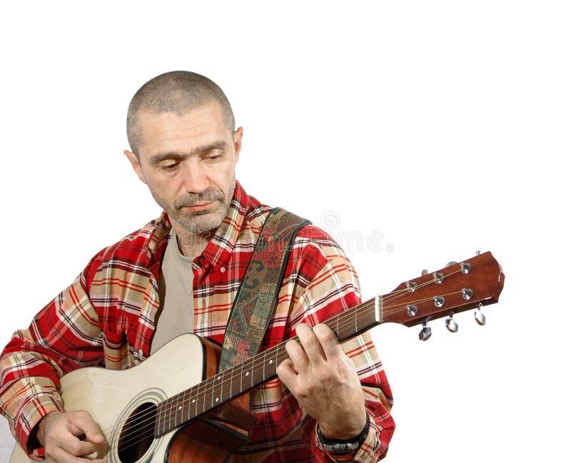 Κιθάρα παιχνιδιού ατόμων στοκ φωτογραφία