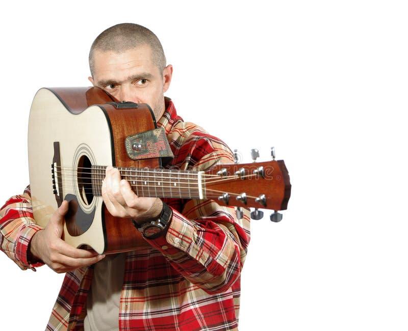 Κιθάρα παιχνιδιού ατόμων στοκ εικόνες