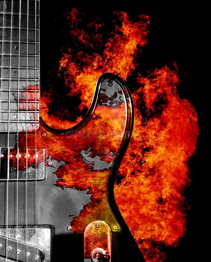 Κιθάρα στην πυρκαγιά στοκ εικόνες