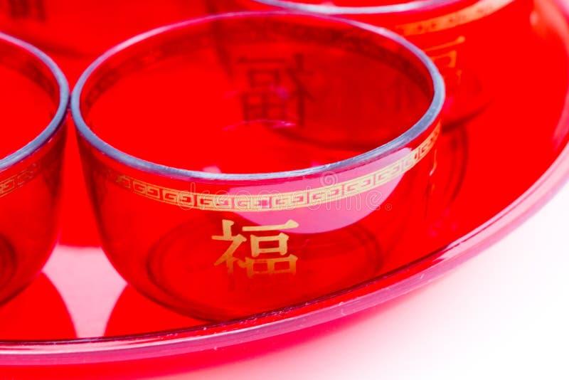 Κινεζικό κόκκινο κύπελλο τσαγιού κινηματογραφήσεων σε πρώτο πλάνο που απομονώνεται στο άσπρο υπόβαθρο στοκ εικόνες