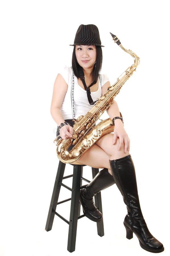 κινεζικό saxophone παιχνιδιού κο στοκ φωτογραφίες