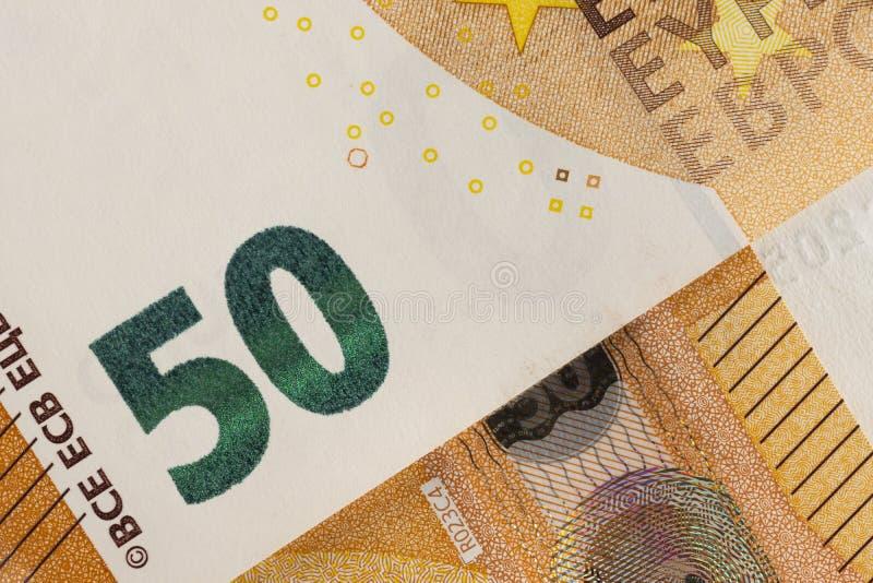 Κινηματογράφηση σε πρώτο πλάνο του ευρωπαϊκού νομίσματος - λογαριασμοί 50 ευρώ στοκ φωτογραφία