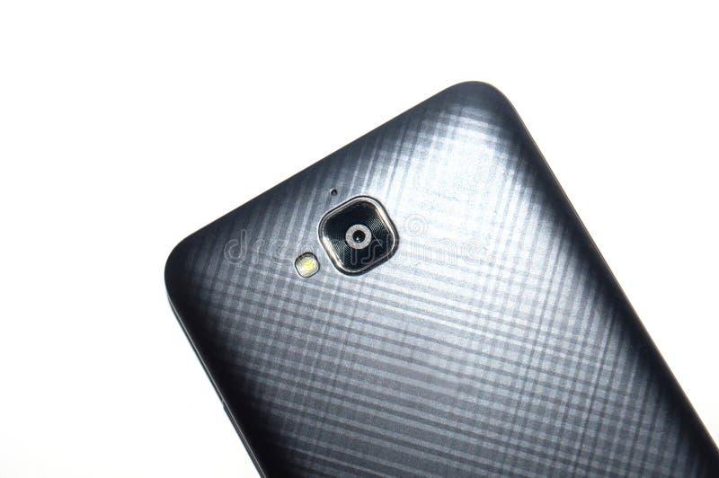 Κινηματογράφηση σε πρώτο πλάνο smartphone καμερών Γκρίζο smartphone σε ένα άσπρο υπόβαθρο με μια θέση για το κείμενο, πλάγια όψη στοκ εικόνες