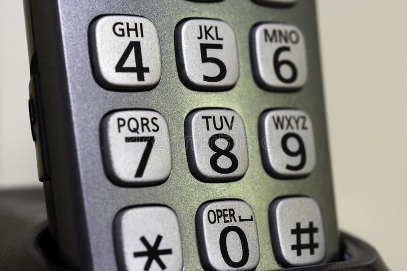 Κινηματογράφηση σε πρώτο πλάνο των ασύρματων αριθμών τηλεφώνου και των επιστολών πλήκτρο τα ΟΝ κάθισμα στοκ εικόνα με δικαίωμα ελεύθερης χρήσης