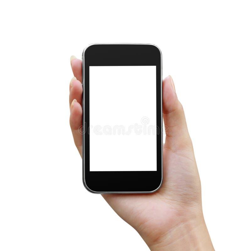 Κινητό τηλέφωνο σε ένα χέρι γυναικών στοκ εικόνες