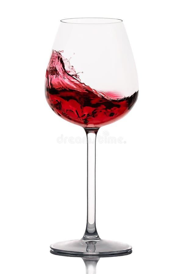 Κινούμενο γυαλί κόκκινου κρασιού πέρα από ένα άσπρο υπόβαθρο στοκ φωτογραφία