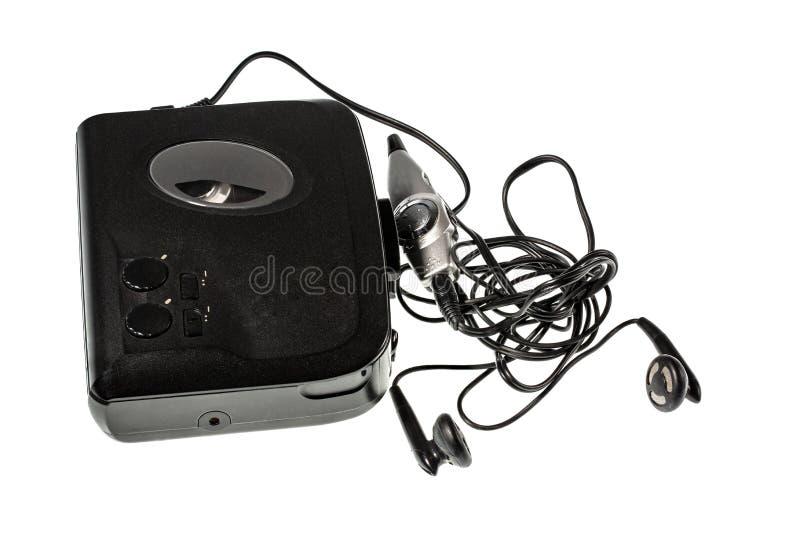 Κλείστε επάνω την άποψη του ακουστικών φορέα και των ακουστικών που απομονώνονται Παλαιά υπόβαθρα τεχνολογίας στοκ φωτογραφίες