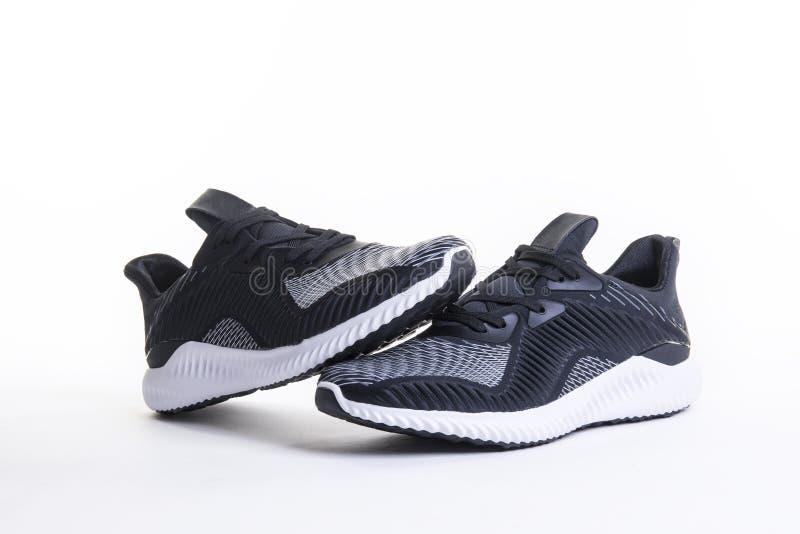 Κλείστε επάνω την άποψη του μαύρου παπουτσιού αθλητικών τρεξίματος και ικανότητας, πάνινα παπούτσια στοκ φωτογραφία με δικαίωμα ελεύθερης χρήσης