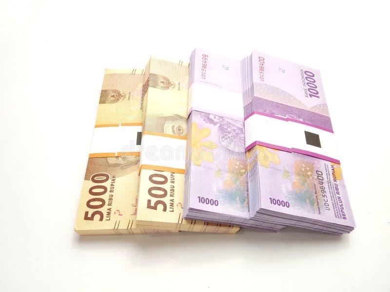 Κλείστε επάνω, τοπ άποψη, απλή φωτογραφία φωτογραφιών, τοπ άποψη, πακέτα των χρημάτων της Ινδονησίας ρουπίων, το 2000, 5000, 1000 στοκ φωτογραφία