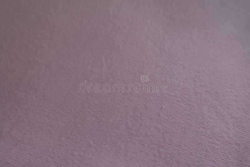 Κλείστε επάνω του απλού ανοικτό ροζ υφάσματος στοκ εικόνα με δικαίωμα ελεύθερης χρήσης
