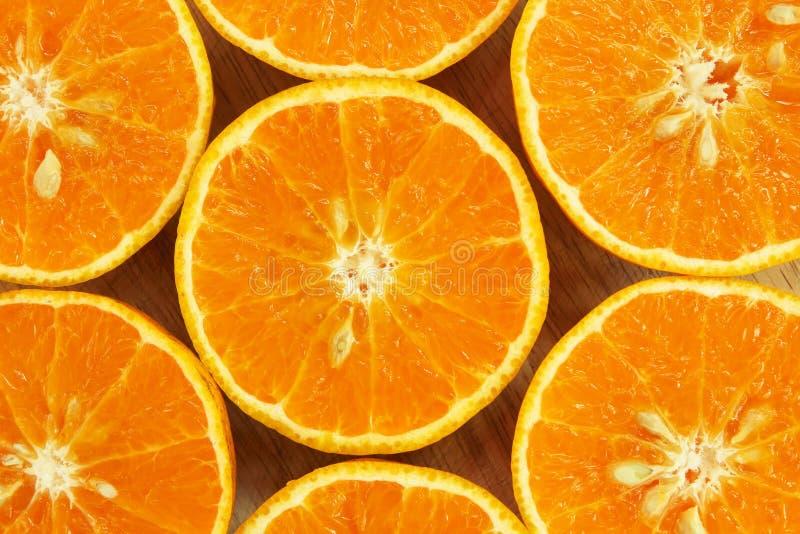 Κλείστε επάνω του φρέσκου υποβάθρου σύστασης φετών φρούτων πορτοκαλιών στοκ φωτογραφία