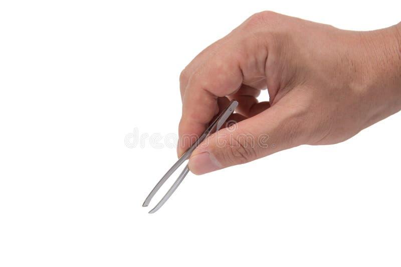 Κλείστε επάνω του χεριού ατόμων ` s κρατώντας τα τσιμπιδάκια στοκ φωτογραφίες με δικαίωμα ελεύθερης χρήσης