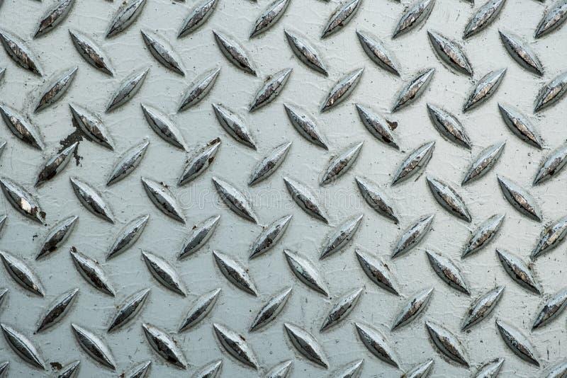 Κλείστε επάνω του χρησιμοποιημένου τραχιού φύλλου χάλυβα με το πιάτο pattern/me διαμαντιών στοκ εικόνες με δικαίωμα ελεύθερης χρήσης