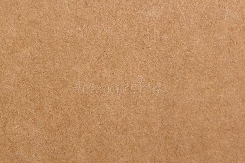Κλείστε επάνω το ανακύκλωσης χαρτόνι ή το καφετί υπόβαθρο σύστασης κιβωτίων εγγράφου του Κραφτ πινάκων στοκ φωτογραφία με δικαίωμα ελεύθερης χρήσης