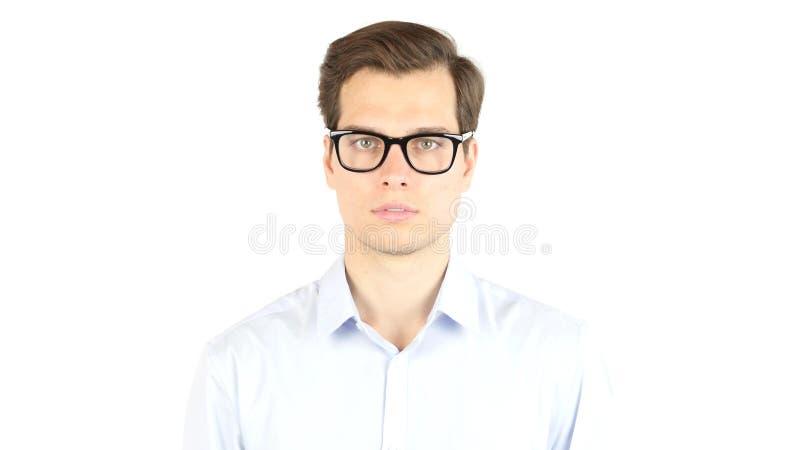 Κλείστε επάνω το νέο επιχειρηματία που φορά Eyeglasses, εξετάζοντας τη κάμερα στοκ φωτογραφία