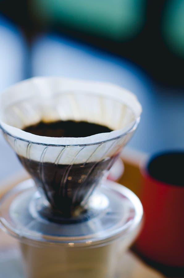 Κλείστε επάνω το στάλαγμα καφέ Ακόμα φωτογραφία ζωής, εξάρτηση για την παραγωγή στοκ φωτογραφία με δικαίωμα ελεύθερης χρήσης