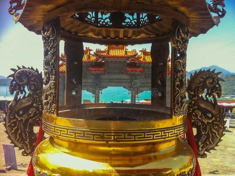 Κλείστε επάνω το χρυσό ραβδί κινέζικων ειδώλων στοκ εικόνες