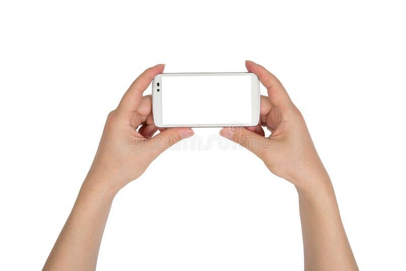 Κλείστε επάνω το smartphone λαβής χεριών που απομονώνεται στοκ εικόνες