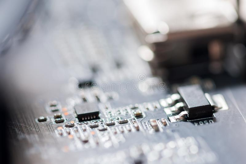 Κλείστε επάνω των κυκλωμάτων ηλεκτρονικών στον πίνακα λογικής υποβάθρου υπολογιστών τεχνολογίας Mainboard, μητρική κάρτα ΚΜΕ, κύρ στοκ εικόνες