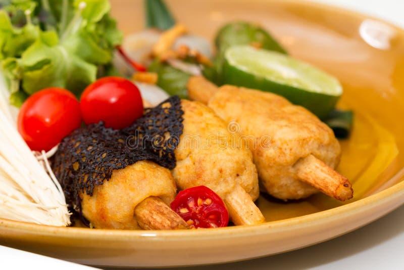 Κλείστε επάνω των τριζάτων γαρίδων που τυλίγονται με τον κάλαμο ζάχαρης στοκ εικόνες με δικαίωμα ελεύθερης χρήσης