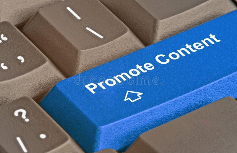 Κλειδί για να προωθήσει το περιεχόμενο στοκ φωτογραφία με δικαίωμα ελεύθερης χρήσης