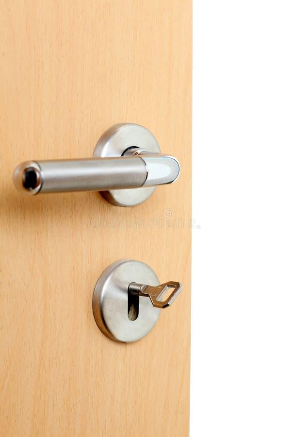 Κλειδί και κλειδαριά μιας ανοιχτής πόρτας στοκ φωτογραφία με δικαίωμα ελεύθερης χρήσης