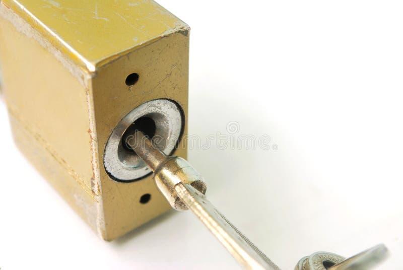 Κλειδί κλειδαριών σπιτιών στοκ εικόνες με δικαίωμα ελεύθερης χρήσης