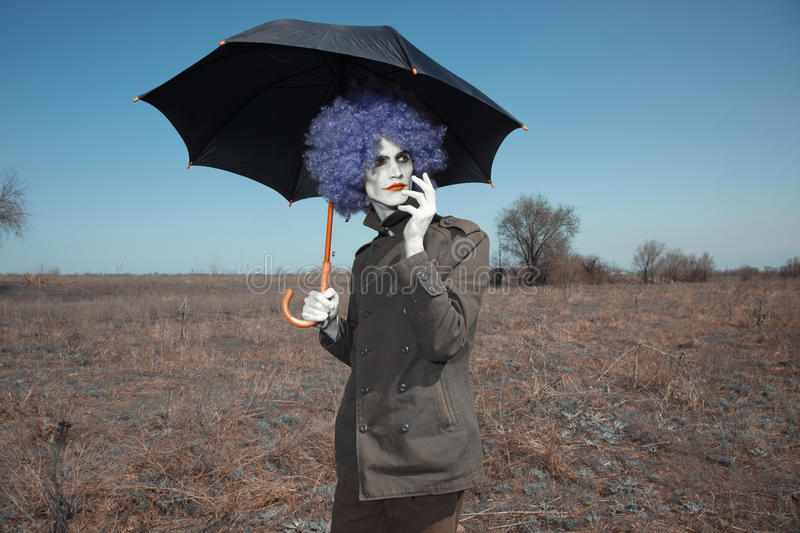 Κλόουν με την ομπρέλα στοκ εικόνες