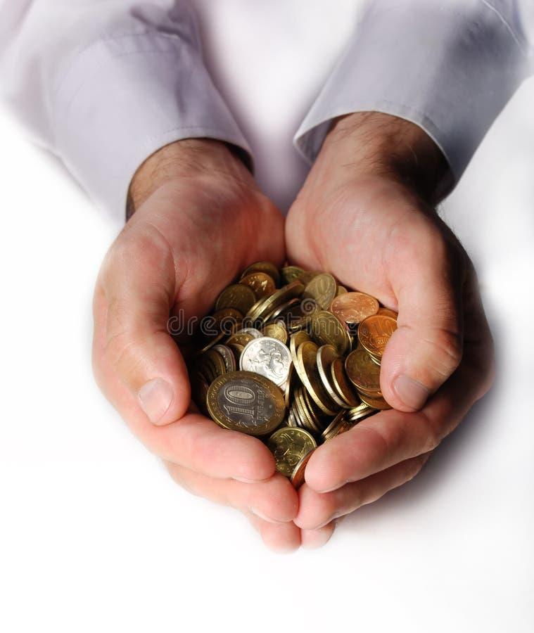 κοίλα νομίσματα χέρια στοκ εικόνες