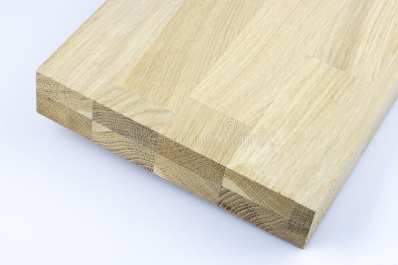 Κολλημένη ξύλινη δομή Βιομηχανική ξύλινη σύσταση ξυλείας, υπόβαθρο ακρών ξυλείας Τέλος άκρης μιας επεξεργασμένης ξύλινης ακτίνας στοκ φωτογραφία με δικαίωμα ελεύθερης χρήσης
