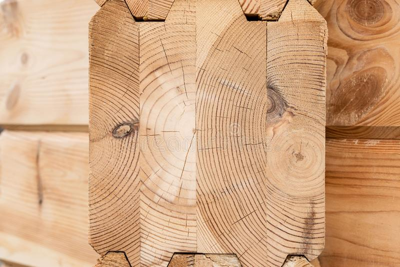 Κολλημένος ξύλο στενός επάνω ξυλείας Ξύλινο υπόβαθρο τελών ξυλείας σιταριού Κολλημένες ακτίνες ξυλείας πεύκων Ξύλο για την οικοδό στοκ εικόνες