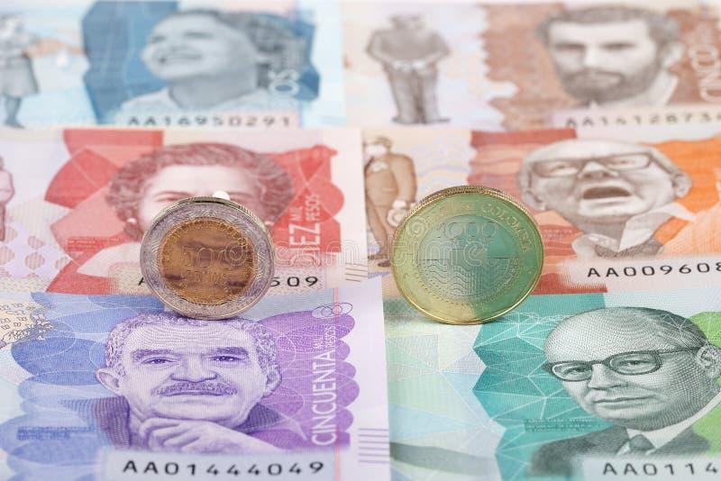 Κολομβιανά νομίσματα πέσων στοκ φωτογραφίες
