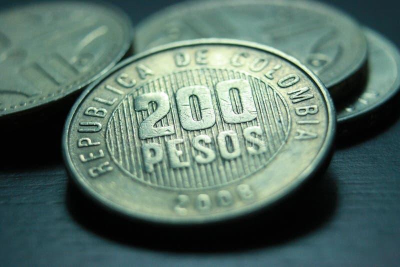 Κολομβιανά νομίσματα στοκ εικόνες