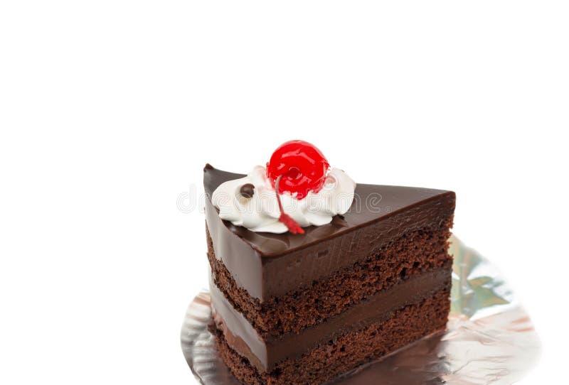 Κομμάτι του κέικ και του κερασιού σοκολάτας στοκ εικόνα